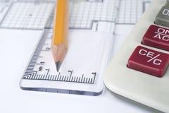Lápiz, regla y calculadora Fotografía de archivo libre de regalías