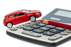 Lápiz y calculadora autos, rojos Fotografía de archivo libre de regalías