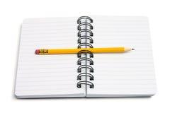 Lápiz y cuaderno Imagenes de archivo