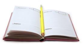 Lápiz y cuaderno Imágenes de archivo libres de regalías