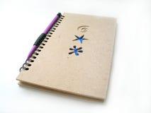 Lápiz y diario Imagen de archivo libre de regalías