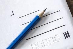 Lápiz y letra Fotografía de archivo libre de regalías