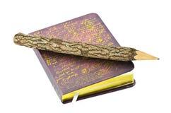 Lápiz y libro. imagen de archivo