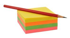 Lápiz y notas pegajosas Imagen de archivo libre de regalías