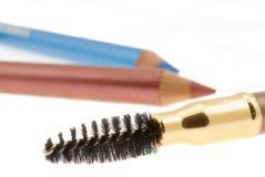 Lápiz y rimel del maquillaje Imagen de archivo