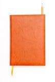 Lápiz y señal del cuaderno de Brown aislados en el blanco Fotografía de archivo libre de regalías