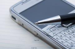 Lápiz y teléfono celular Fotografía de archivo libre de regalías
