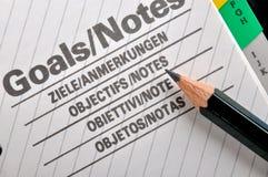 Lápiz y trabajo de las metas Imágenes de archivo libres de regalías