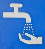Lávese las manos aquí Imagen de archivo libre de regalías