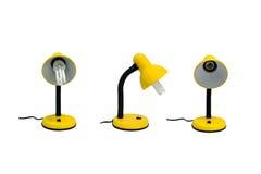 Lâmpada amarela em um fundo branco Fotografia de Stock Royalty Free