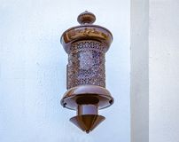 Lâmpada antiga na parede Imagem de Stock