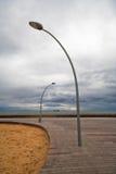 Lâmpada de rua dois no cais Fotografia de Stock Royalty Free