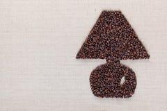 Lâmpada dos feijões de café textura de linho no direito alinhado imagem de stock
