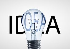 Lâmpada e texto da ideia Imagens de Stock