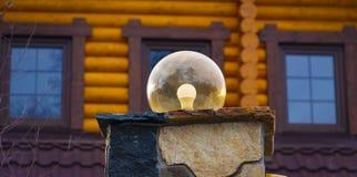 Lâmpada na parede da cerca da casa Fotos de Stock