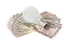 Lâmpada que encontra-se no dinheiro Fotos de Stock Royalty Free