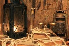 Lâmpada velha com vela iluminada Foto de Stock Royalty Free