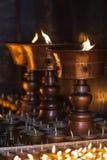 Lâmpadas de óleo rituais grandes e pequenas Fotos de Stock