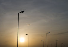 Lâmpadas de rua alinhadas Imagem de Stock
