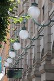 Lâmpadas de rua na parede Imagem de Stock Royalty Free