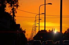 Lâmpadas de rua no por do sol Imagens de Stock