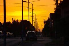 Lâmpadas de rua no por do sol Imagem de Stock Royalty Free
