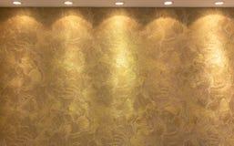 Lâmpadas douradas da iluminação do fundo da textura Foto de Stock