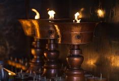 Lâmpadas grandes da manteiga no templo Imagem de Stock Royalty Free