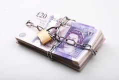 låsta pengar Arkivbild
