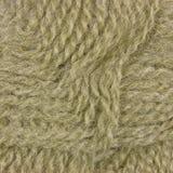 A lã fina bege natural rosqueia o teste padrão textured detalhado do close up do clew do fio do detalhe da textura fundo macro Foto de Stock