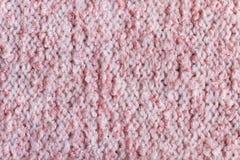 Lãs cor-de-rosa close up feito malha do fundo Imagens de Stock