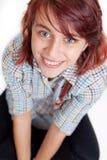 Lächeln des glücklichen jugendlich weiblichen Kursteilnehmers Stockbild