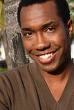 Lächeln des jungen Mannes Stockfotografie