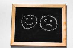 Lächeln gemalt auf einer Tafel, Lizenzfreies Stockbild