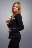 Lächeln-Geschäftsfrau mit Glasporträt Stockfoto