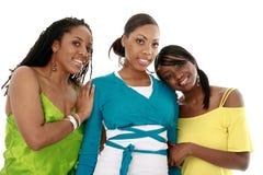 Lächeln mit drei Freunden Lizenzfreie Stockfotos