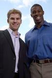 Lächeln mit zwei Geschäftsleuten Lizenzfreies Stockbild