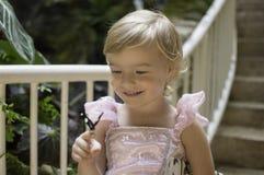 Lächeln am Schmetterling Stockfotos