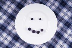 Lächeln von Beeren Stockfotos
