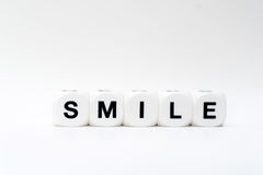 Lächeln, Würfelbuchstaben Lizenzfreie Stockfotos
