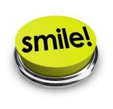 Lächeln-Wort-Gelb-Knopf-lustiger Humor-guter Geist Stockfoto