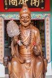 Lächelnbuddha-Chinesegott Stockfotos
