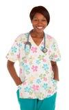 Lächelnde Afroamerikaner-Krankenschwester-Aufstellung Stockfoto