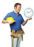 Lächelnde Arbeitskraft und Zeit stockfotos