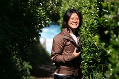 Lächelnde asiatische Frau stockbilder