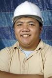Lächelnde asiatische Fremdfirma Lizenzfreies Stockfoto