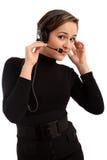 Lächelnde Bedienerfrau in einem Kundenkontaktcenter Stockfotos