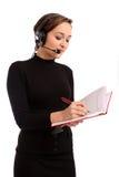 Lächelnde Bedienerfrau in einem Kundenkontaktcenter Stockfotografie