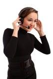 Lächelnde Bedienerfrau in einem Kundenkontaktcenter Lizenzfreie Stockbilder