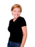 Lächelnde blonde Frau über weißem Hintergrund Lizenzfreies Stockfoto